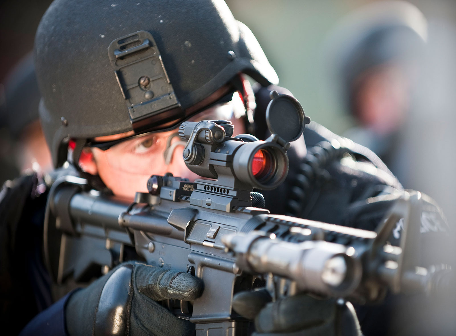 Combat operator using a rifle with the aimpoint pro attached